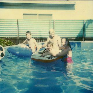 Joe grandpa me and cathy in pool